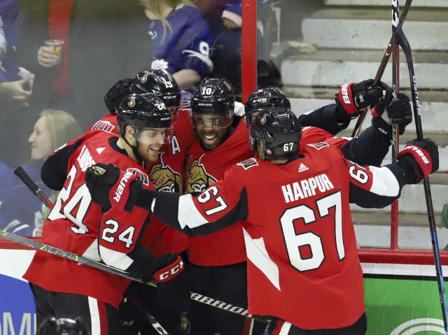 Ottawa Senators left wing Anthony Duclair (10) celebrates his goal against the Toronto Maple Leafs with teammates Oscar Lindberg (24), Zack Smith (15), Dylan DeMelo (2) and Ben Harpur (67) during the third period of an NHL hockey game in Ottawa, Saturday, March 16, 2019. (Fred Chartrand/The Canadian Press via AP)