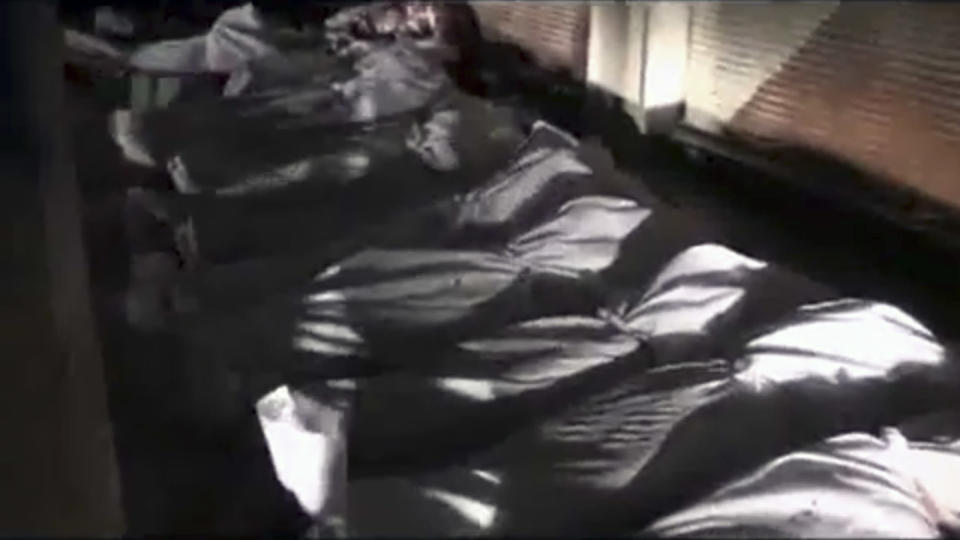 This image made from amateur video released by Shaam News Network and accessed Friday, June 29, 2012, purports to show shrouded bodies in Douma, a suburb of Damascus, Syria. (AP Photo/Shaam News Network via AP video) THE ASSOCIATED PRESS CANNOT INDEPENDENTLY VERIFY THE CONTENT, DATE, LOCATION OR AUTHENTICITY OF THIS MATERIAL
