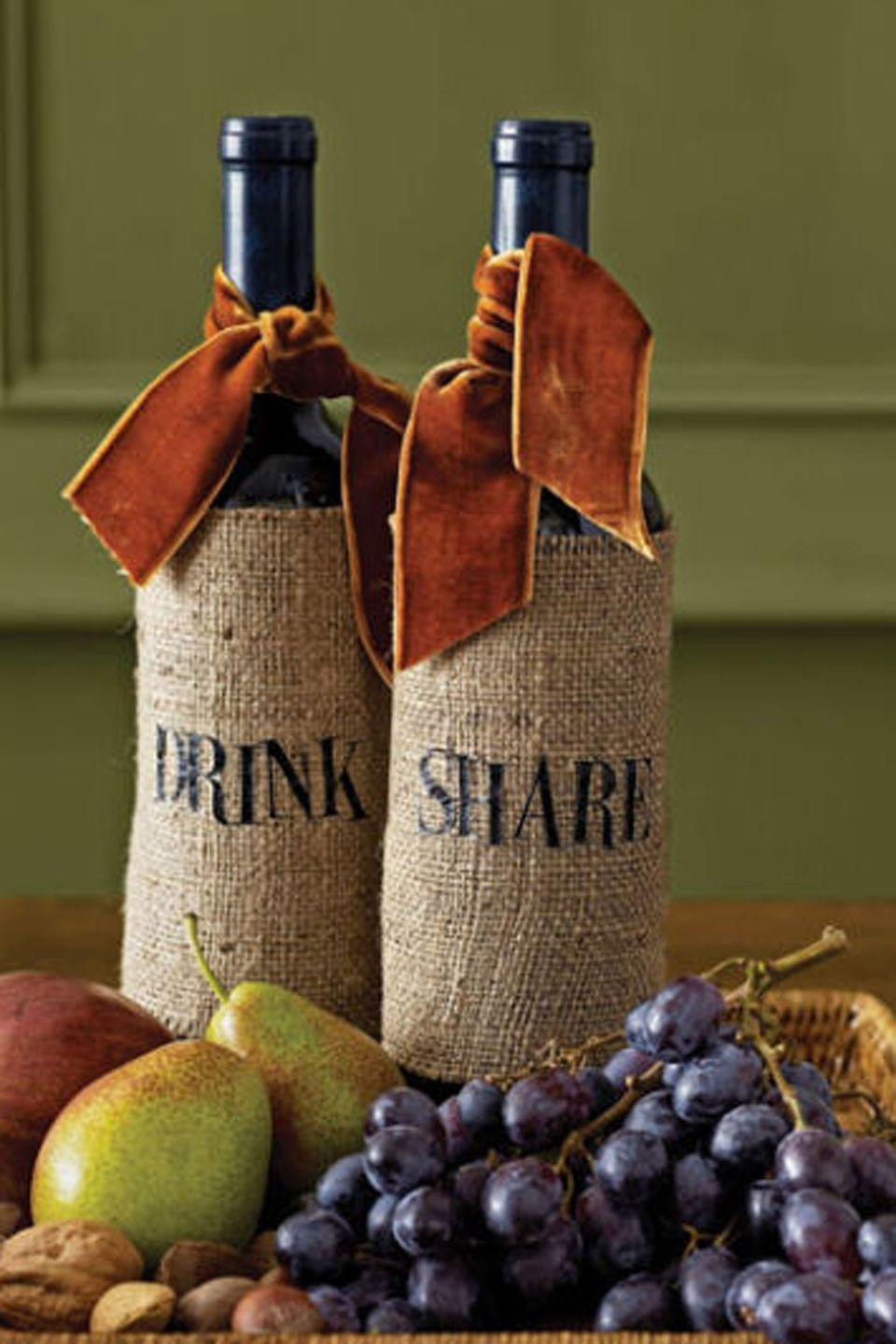 <p>A scrap of rustic burlap, wrapped around a regional wine and topped with a lush remnant of velvet ribbon, is elevated to the truly elegant. Stencil the hostess's initials or a short greeting for an extra touch.</p>