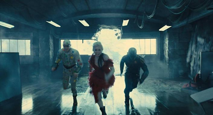 """Margot Robbie, who played villain Harley Quinn in the first """"Suicide Squad"""" and """"Birds of Prey,"""" reprises her role in the new """"The Suicide Squad,"""" joined by newcomers to the franchise David Dastmalchian, left, as Polka-Dot Man and Idris Elba as Bloodsport."""