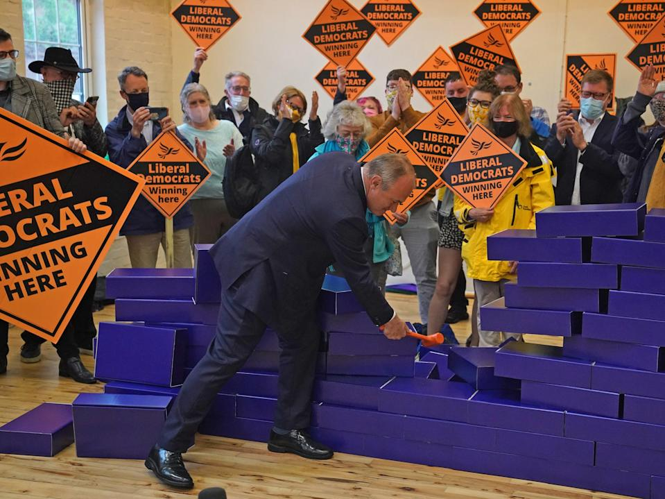 Sir Ed Davey smashing symbolic blue wall after by-election win in Chesham and Amersham (PA)
