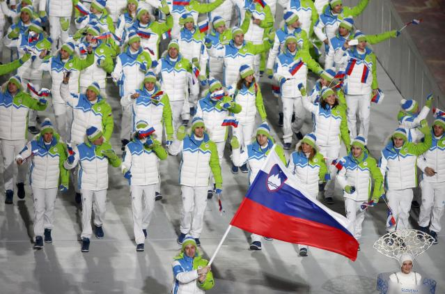 Slovenia's flag-bearer Tomaz Razingar leads his country's contingent during the athletes' parade at the opening ceremony of the 2014 Sochi Winter Olympics, February 7, 2014. REUTERS/Lucy Nicholson (RUSSIA - Tags: OLYMPICS SPORT)