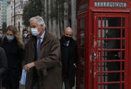 EU Chief Negotiator Michel Barnier walks to a conference centre in Westminster in London, Sunday, Nov. 29, 2020. Teams from Britain and the European Union are continuing face-to-face talks on a post-Brexit trade deal in the little remaining time. (AP Photo/Kirsty Wigglesworth)
