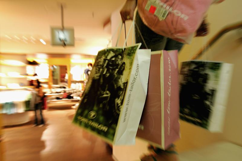 HAMBURG, GERMANY - JULY 28: A woman leaves with full shopping bags at a department store on July 28, 2005 in Hamburg,Germany. The Summer Sales started on July 25 and many shops are offering discounts of up to 70 per cent. Sparked by the election manifesto of the opposition party CDU, Germany currently debates wether raising the Mehrwertsteuer (VAT) would in fact promote economic growth or if it would have the opposite effect by hurting families and low-income households. (Photo Illustration by Andreas Rentz/Getty Images)