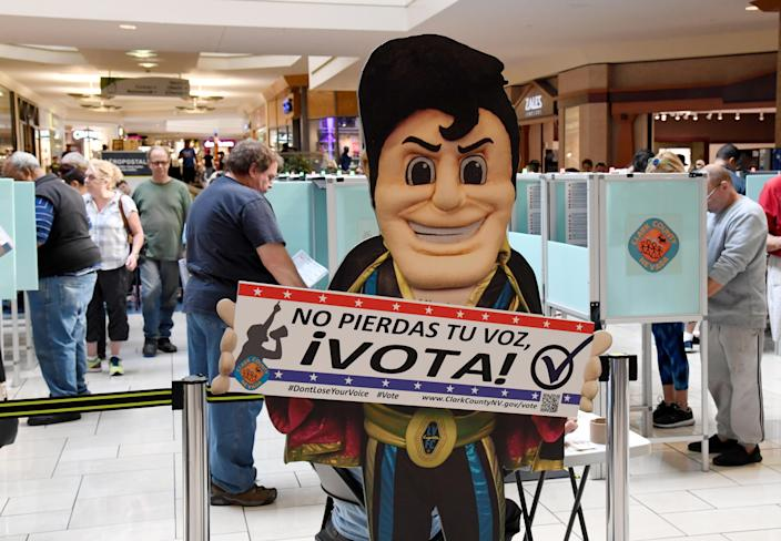 People vote behind an Elvis Presley-themed cardboard cutout on the first day of early voting at the Meadows Mall in Las Vegas on Oct. 20, 2018. (Photo: Ethan Miller/Getty Images)