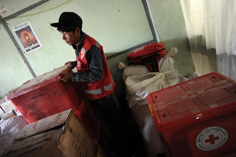 A Myanmar Red Cross Societly member checks a medical delivery for conflict areas near the Chinese border, at Lashio, on February 20, 2015 (AFP Photo/Ye Aung Thu)
