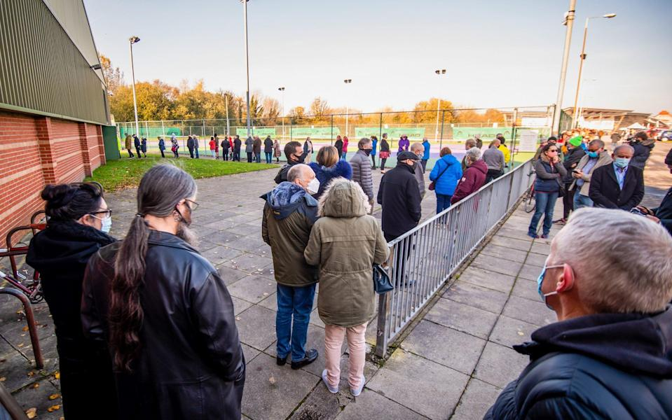 Visitors queue to enter a coronavirus testing centre, run by the Army, at Liverpool Tennis Centre in early November - Anthony Devlin/Bloomberg