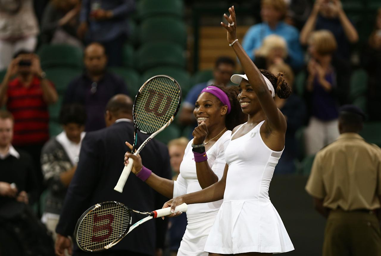 LONDON, ENGLAND - JULY 07:  Serena Williams (L) and Venus Williams of the USA celebrate after their Ladies? Doubles final match against Andrea Hlavackova and Lucie Hradecka of the Czech Republic on day twelve of the Wimbledon Lawn Tennis Championships at the All England Lawn Tennis and Croquet Club on July 7, 2012 in London, England.  (Photo by Paul Gilham/Getty Images)