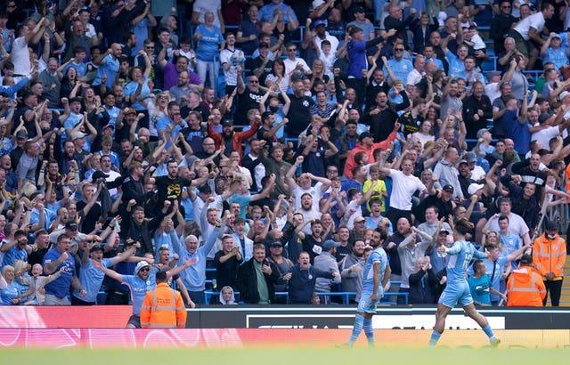 Manchester City's Ilkay Gundogan celebrates his opening goal in a 5-0 win over Arsenal in front of the home fans as Jack Grealish joins him