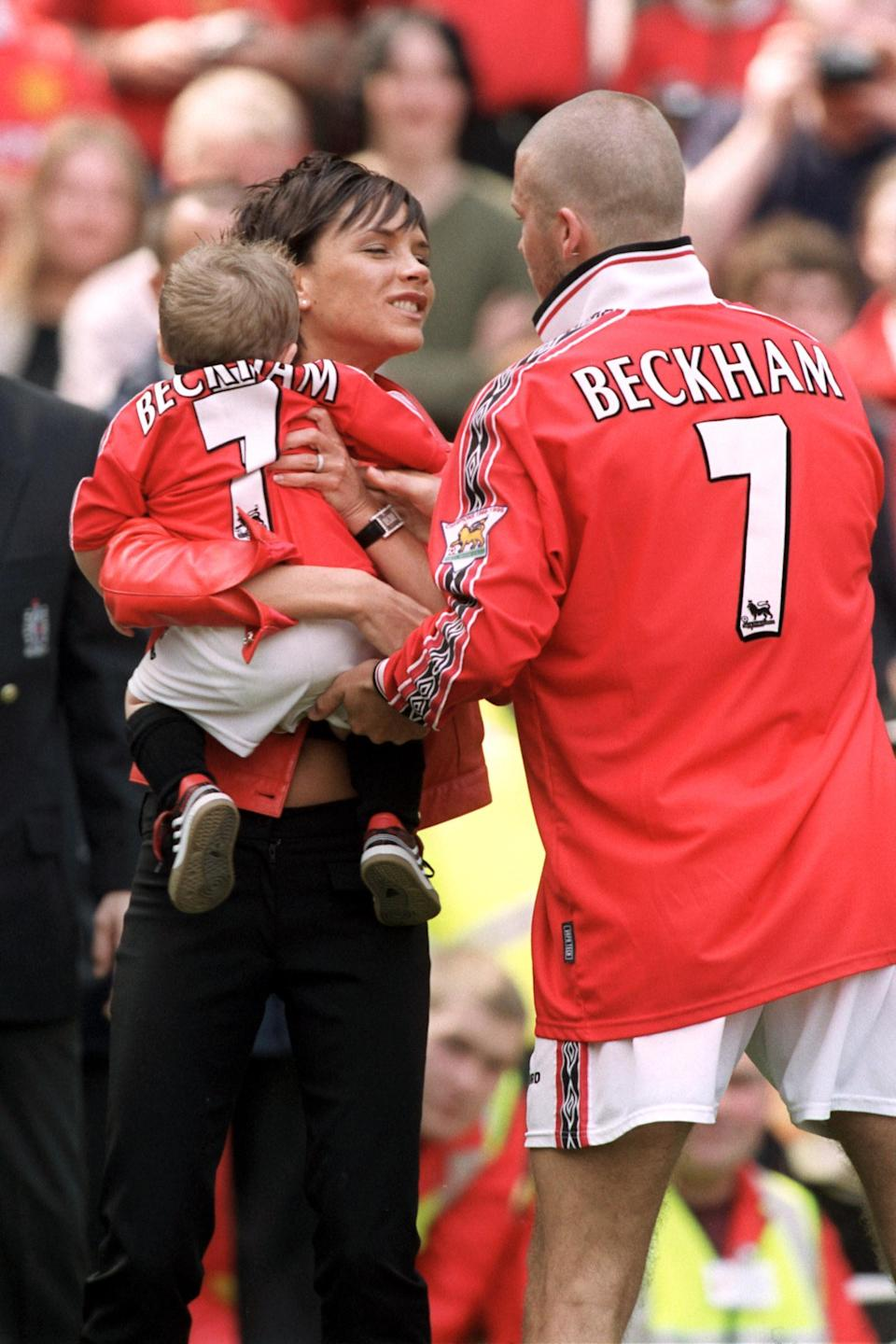 Victoria brought along their first child, Brooklyn, to watch Manchester United take on Tottenham Hotspur in March, 1999 [Photo: PA]