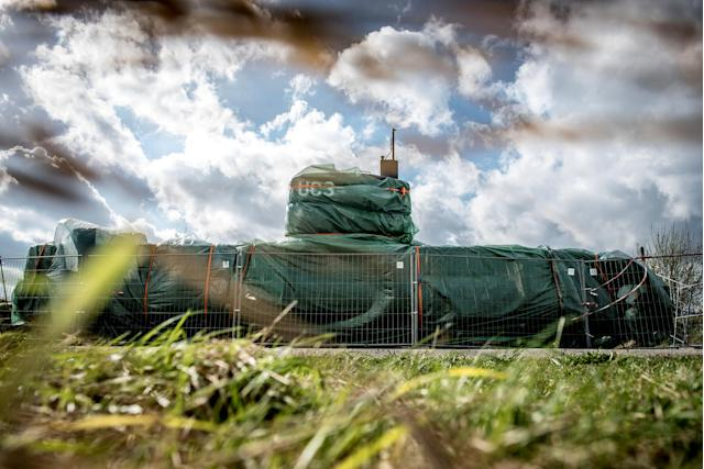 "The submarine UC3 Nautilus is seen covered with green tarpaulin in Nordhavn, in Copenhagen, Denmark, April 25, 2018. Danish inventor Peter Madsen has been sentenced to life in prison for torturing and murdering Swedish journalist Kim Wall on his private submarine, it was also decided by the court that the submarine ""UC3 Nautilus"" must be confiscated. RITZAU SCANPIX/Mads Claus Rasmussen via REUTERS ATTENTION EDITORS - THIS IMAGE WAS PROVIDED BY A THIRD PARTY. DENMARK OUT. NO COMMERCIAL OR EDITORIAL SALES IN DENMARK TPX IMAGES OF THE DAY"