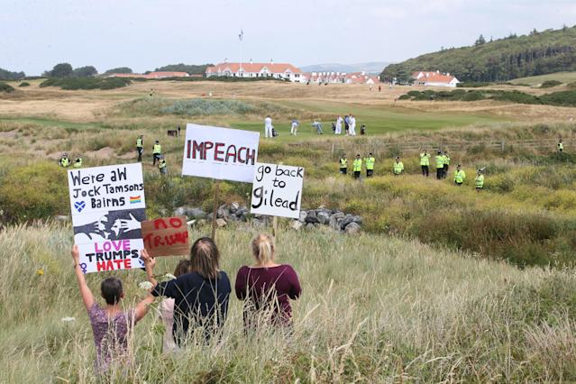<p>Trump protesters gather on the dunes near the Trump Turnberry golf resort in South Ayrshire, where President Trump and first lady Melania Trump are spending the weekend. (Photo: Jane Barlow/PA Images via Getty Images) </p>