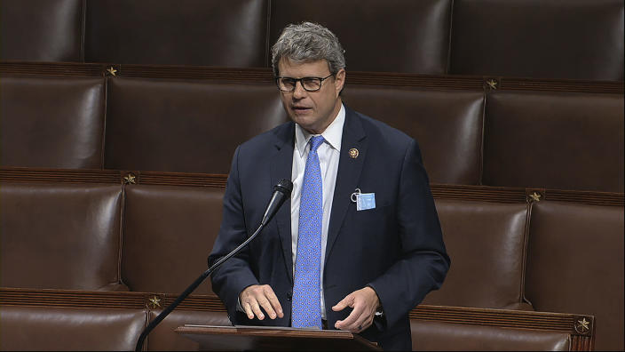 FILE - In this April 23, 2020, image from video, Rep. Bill Huizenga, R-Mich., speaks on the floor of the House of Representatives at the U.S. Capitol in Washington. Huizenga tweeted Wednesday, Oct. 14 that he tested positive for COVID-19 in a rapid test before he was scheduled to appear at a Michigan campaign rally with Vice President Mike Pence. (House Television via AP, File)