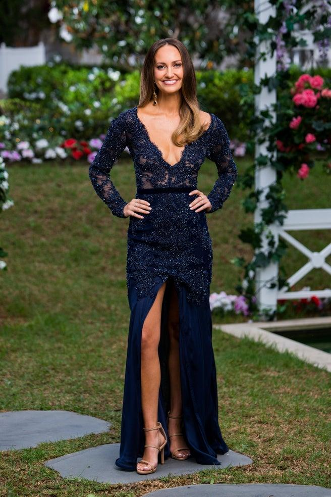Emma Roche in a navy dress on The Bachelor