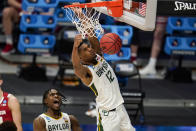 Baylor's Davion Mitchell (45) reacts as Jared Butler (12) gets a dunk against Wisconsin in the first half of a second-round game in the NCAA men's college basketball tournament at Hinkle Fieldhouse in Indianapolis, Sunday, March 21, 2021. (AP Photo/Michael Conroy)