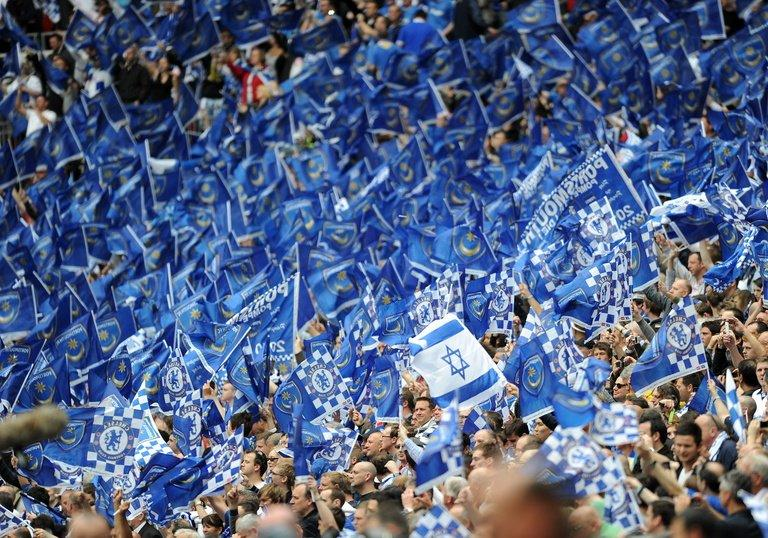 Portsmouth supporters cheer during the FA Cup Final football match at Wembley, in north London, on May 15, 2010