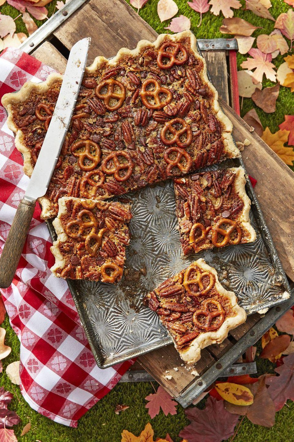 "<p>A sheet pan serves-a-crowd option for the pecan pie lovers out there. Pretzels add pops of saltiness to an otherwise sweet, chocolatey pie.</p><p><em><a href=""https://www.countryliving.com/food-drinks/a24277219/pretzel-chocolate-pecan-slab-pie-recipe/"" rel=""nofollow noopener"" target=""_blank"" data-ylk=""slk:Get the recipe from Country Living »"" class=""link rapid-noclick-resp"">Get the recipe from Country Living »</a></em></p>"