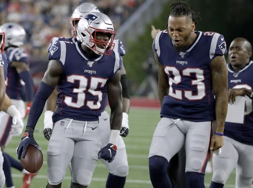New England Patriots defensive back Keion Crossen celebrates his interception with Patrick Chung, right, in the first half of an NFL preseason football game against the New York Giants, Thursday, Aug. 29, 2019, in Foxborough, Mass. (AP Photo/Elise Amendola)