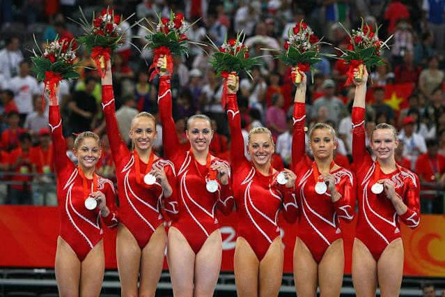 (L-R) Shawn Johnson, Nastia Liukin, Chellsie Memmel, Samantha Peszek, Alicia Sacramone and Bridget Sloan of the United States women's gymnastics team celebrates after receiving the silver medal in the artistic gymnastics team event at the National Indoor Stadium during Day 5 of the Beijing 2008 Olympic Games on August 13, 2008 in Beijing, China.