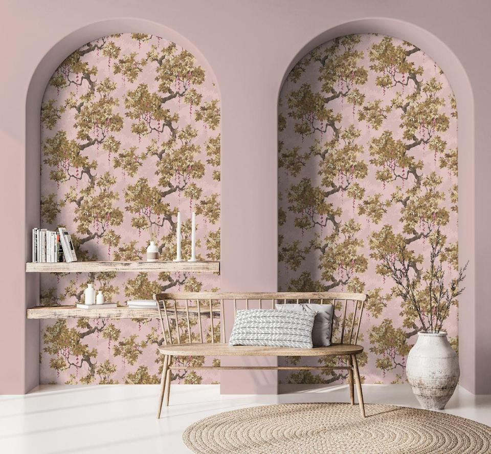 """<p>Do you have arched alcoves in your living room? This more traditional, retro-style floral wallpaper is used in a wonderful way. The patterned paper really makes these arches stand out, especially set against the plain dusky pink wall. Shelves have been placed in front of it, but it's the shape that adds personality to this room and showcases the wallpaper. </p><p>Pictured: Floresta wallpaper in pink; Pink Cloud emulsion, both <a href=""""https://www.woodchipandmagnolia.co.uk/"""" rel=""""nofollow noopener"""" target=""""_blank"""" data-ylk=""""slk:Woodchip & Magnolia"""" class=""""link rapid-noclick-resp"""">Woodchip & Magnolia</a></p>"""