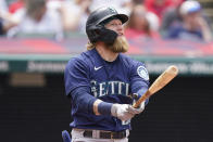 Seattle Mariners' Jake Fraley watches his ball after hitting a two-run home run in the fourth inning of a baseball game against the Cleveland Indians, Sunday, June 13, 2021, in Cleveland. (AP Photo/Tony Dejak)