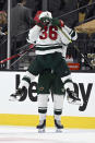 Minnesota Wild right wing Mats Zuccarello (36) and left wing Marcus Foligno celebrate their overtime victory over the Vegas Golden Knights in Game 1 of a first-round NHL hockey playoff series Sunday, May 16, 2021, in Las Vegas. (AP Photo/David Becker)