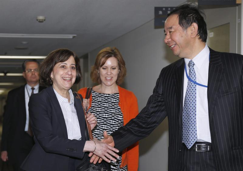 Acting Deputy U.S. Trade Representative Cutler shakes hands with Japan's deputy chief negotiator Oe ahead of their meeting for the TPP free trade negotiation, at the Foreign Ministry in Tokyo