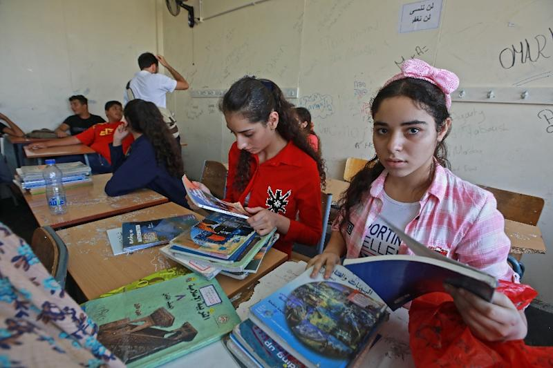 Palestinian students open their books on their first day back at the Haifa school in Beirut administrated by the United Nations (AFP Photo/ANWAR AMRO)