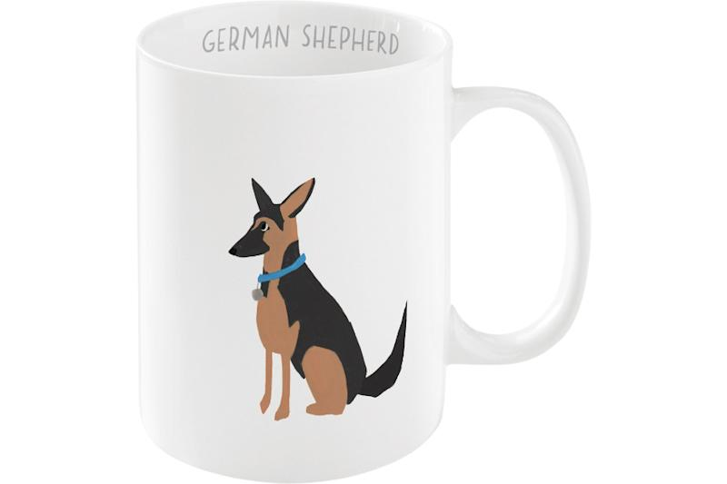 Get a pair of mugs—say a Golden and a German Shepherd—for someone who's dog is a mix. (Photo: Chewy)