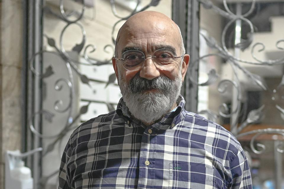 Turkish journalist and writer Ahmet Altan poses for AFP at his home minutes after he arrived following his release from jail, at Kadikoy neighbourhood in Istanbul, on April 14, 2021. - A Turkish court on April 14 released journalist and novelist Ahmet Altan after more than four years in prison on charges of involvement in a failed 2016 coup attempt that he had always denied. The Court of Cassation ruling came a day after the European Court of Human Rights (ECHR) demanded the 71-year-old's freedom in a verdict that accused Turkey of violating his civil rights. The award-winning novelist and newspaper editor was jailed after writing politically-sensitive pieces critical of President Recep Tayyip Erdogan and in support of Kurdish rights. (Photo by BULENT KILIC / AFP) (Photo by BULENT KILIC/AFP via Getty Images)