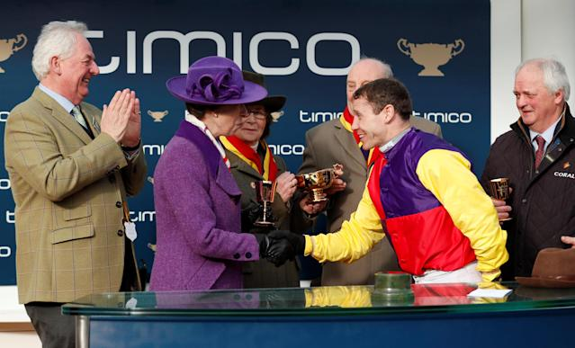 Horse Racing - Cheltenham Festival - Cheltenham Racecourse, Cheltenham, Britain - March 16, 2018 Richard Johnson collects the trophy from Princess Anne after riding Native River to victory in the 15.30 Timico Cheltenham Gold Cup Chase Action Images via Reuters/Andrew Boyers