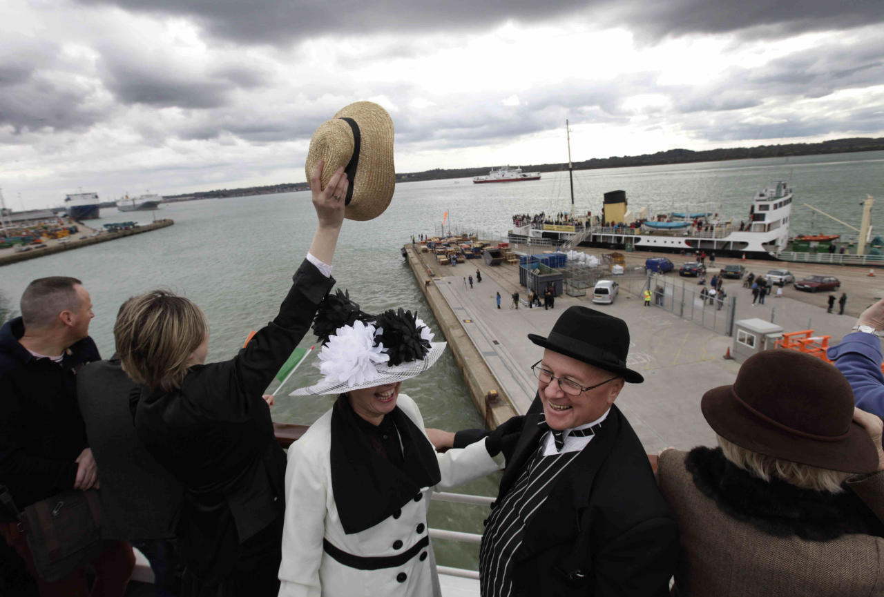 Passengers, some wearing costumes, wave goodbye, as the MS Balmoral Titanic memorial cruise ship sail from Southampton, England, on Easter Sunday, April 8, 2012. Nearly 100 years after the Titanic went down, a cruise with the same number of passengers aboard is setting sail to retrace the ship's voyage, including a visit to the location where it sank. The Titanic Memorial Cruise departed Sunday from Southampton, where the Titanic left on its maiden voyage and the 12-night cruise will commemorate the 100th anniversary of the sinking of the White Star liner. With 1,309 passengers aboard, the MS Balmoral will follow the same route as the Titanic and organizers are trying to recreate the onboard experience minus the disaster from the food to a band playing music from that era. (AP Photo/Lefteris Pitarakis)
