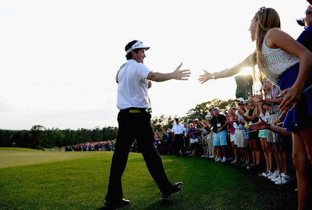 AUGUSTA, GA - APRIL 13: Bubba Watson of the United States walks with his son Caleb behind the 18th green after winning the 2014 Masters Tournament by a three-stroke margin at Augusta National Golf Club on April 13, 2014 in Augusta, Georgia. (Photo by Harry How/Getty Images)