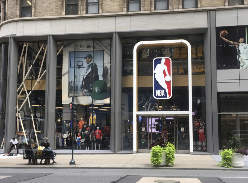 NBA logo in front of an office space.