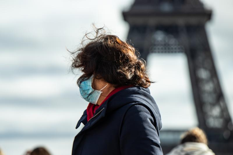 in Paris,in front of the eiffel tower,chinese tourists wear face mask to protect against the coronavirus ,with more and more people infected everyday ,and also in europe,chinese tourists wear protection mask, face mask against the contamination. A woman wearing a mask in the trocadero in front the eiffel tower (Photo by Jerome Gilles/NurPhoto via Getty Images)