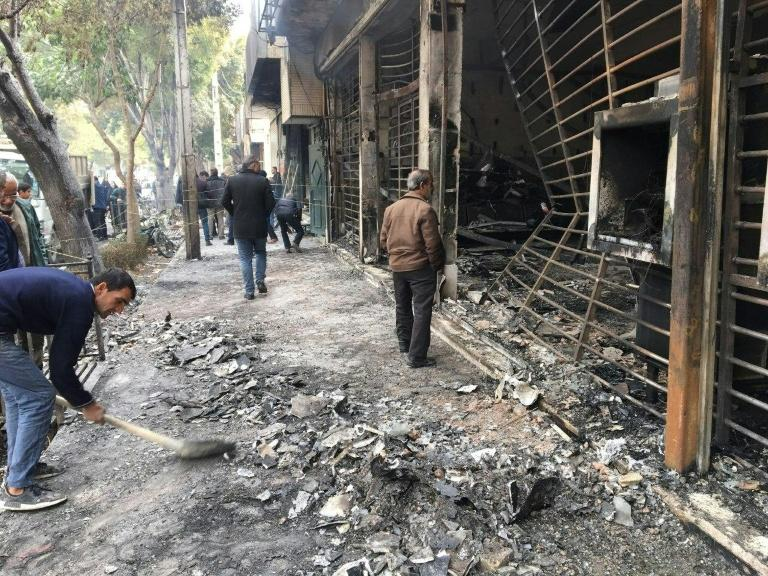This bank was set ablaze by protesters in Iran's central city of Isfahan (AFP Photo/-)