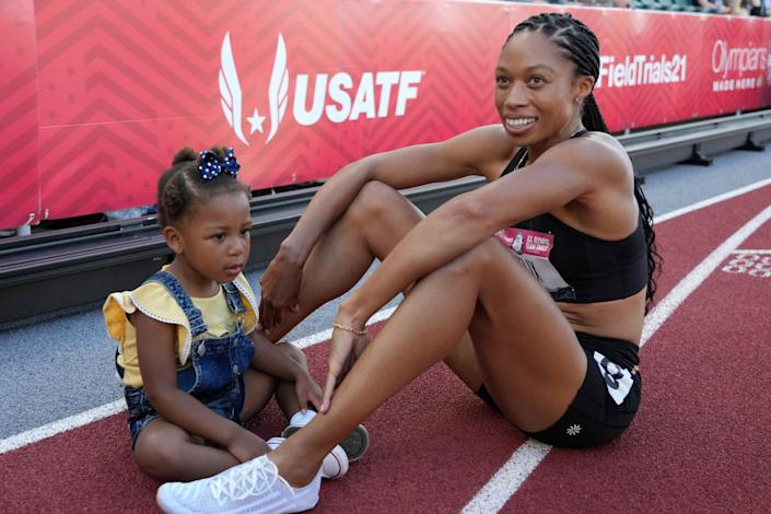 Jun 20, 2021; Eugene, OR, USA; Allyson Felix poses with daughter Camryn Ferguson after placing second in the women's 400m during the US Olympic Team Trials at Hayward Field. Mandatory Credit: Kirby Lee-USA TODAY Sports