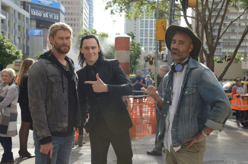 Chris Hemsworth, Tom Hiddleston, and Taika Waititi on the set of 'Thor 3' - Credit: Twitter/Daley_Pearson