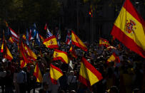 Protesters march holding Spanish flags during a celebration for Spain's National Day in Barcelona, Spain, Tuesday, Oct. 12, 2021. Spain commemorates Christopher Columbus' arrival in the New World and also Spain's armed forces day. (AP Photo/Joan Mateu Parra)