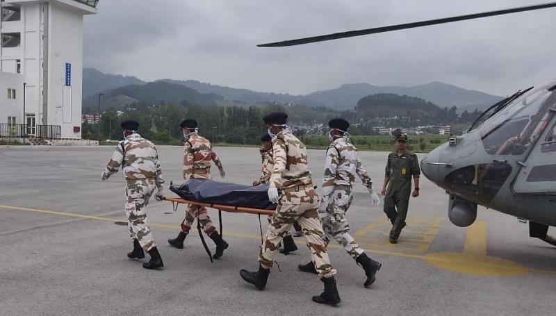 This photo released by Indo Tibetan Border Police (ITBP) shows Indian paramilitary personnel carry one among seven bodies believed to be from a missing team of international climbers after they were evacuated in helicopters from Himalayan mountain Nanda Devi and brought to Pithoragarh, northern India, Wednesday, July 3, 2019. Veteran British mountaineer Martin Moran led three other Britons, two Americans, an Australian and an Indian up Nanda Devi East. Contact was lost after a May 26 avalanche. (Indo Tibetan Border Police via AP)
