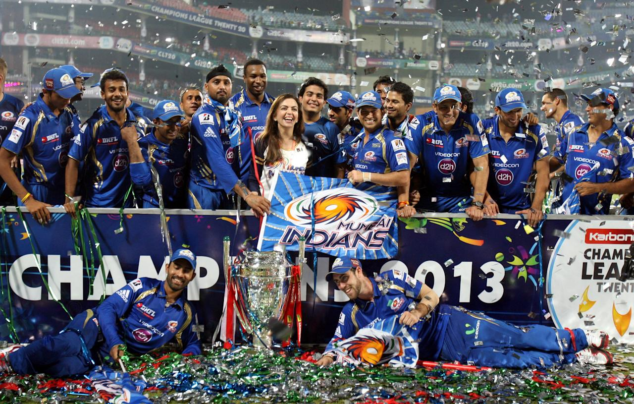 Mumbai Indians team with the CLT20 trophy after wining the final between Rajasthan Royals and Mumbai Indians at Feroz Shah Kotla stadium, in Delhi on Oct. 6, 2013. (Photo: IANS)