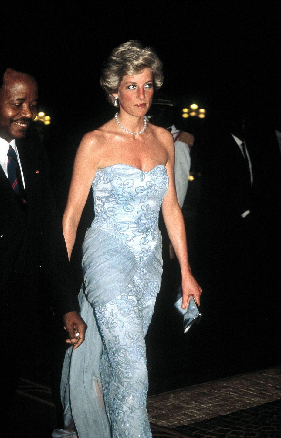 <p>In a Catherine Walker strapless gown at an event in Douala. </p>