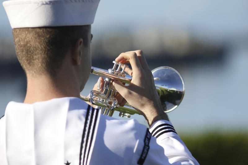 A U.S. Navy sailor plays during a ceremony to mark the 78th anniversary of the Japanese attack on Pearl Harbor, Saturday, Dec. 7, 2019 at Pearl Harbor, Hawaii. Survivors and members of the public gathered in Pearl Harbor to remember those killed when Japanese planes bombed the Hawaii naval base 78 years ago and launched the U.S. into World War II. About a dozen survivors of the attack attended the annual ceremony, the youngest of whom are now in their late 90s. (AP Photo/Caleb Jones)