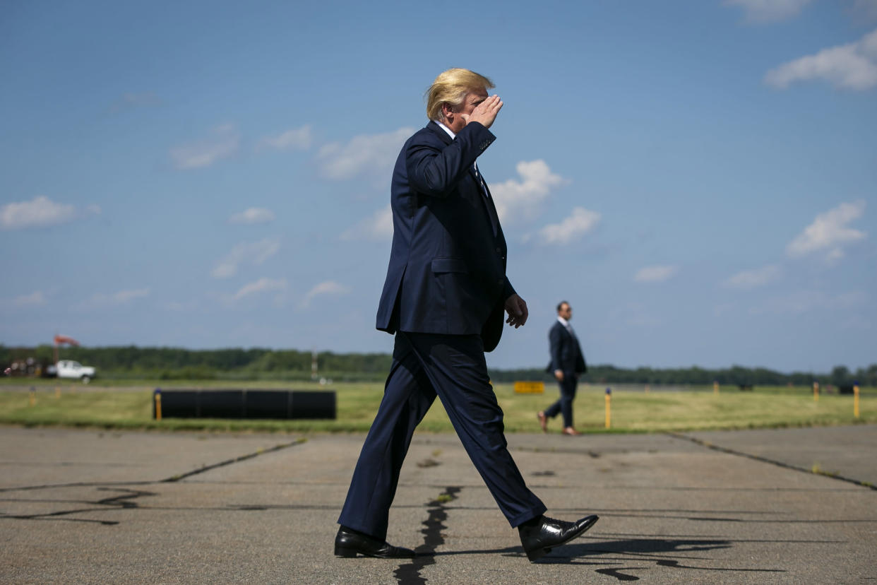 President Donald Trump salutes military servicemen as he boards Air Force One at Morristown Municipal Airport, in Morristown, N.J., July 21, 2019. (Al Drago/The New York Times)