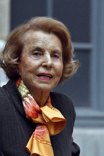 <p>A file picture taken on October 12, 2011 shows the L'Oreal heiress Liliane Bettencourt leaving the Institut de France in Paris. Ex-president Nicolas Sarkozy told judges he received no money from France's richest woman, amid allegations that his 2007 election campaign was illegally financed.</p>