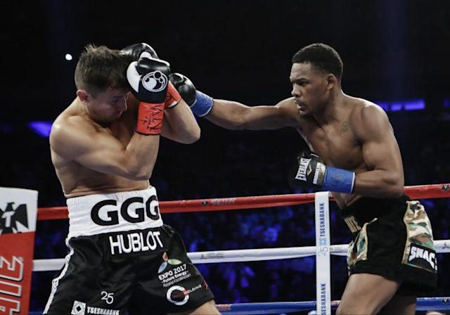 Daniel Jacobs (R) lands a punch on Gennady Golovkin during their title fight on Saturday. (Getty)