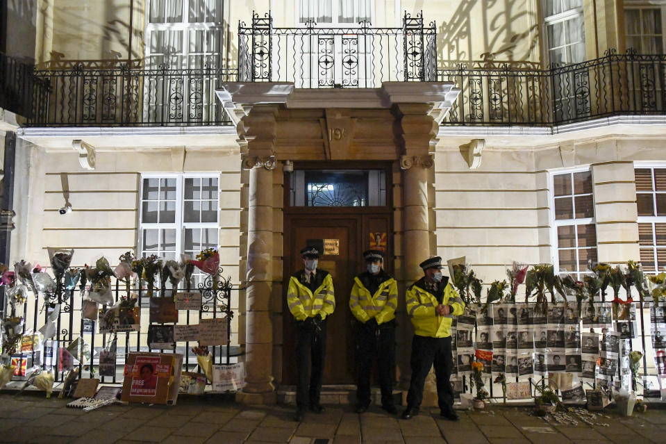 Police officers patrol outside the Myanmar Embassy in London, Wednesday, April 7, 2021. Newspaper reports say the embassy was taken over by members of the country's new military regime Wednesday evening. (AP Photo/Alberto Pezzali)