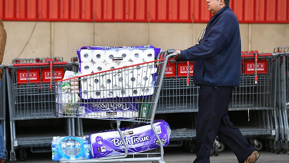 Melbourne shopper stocking up on toilet paper at costco