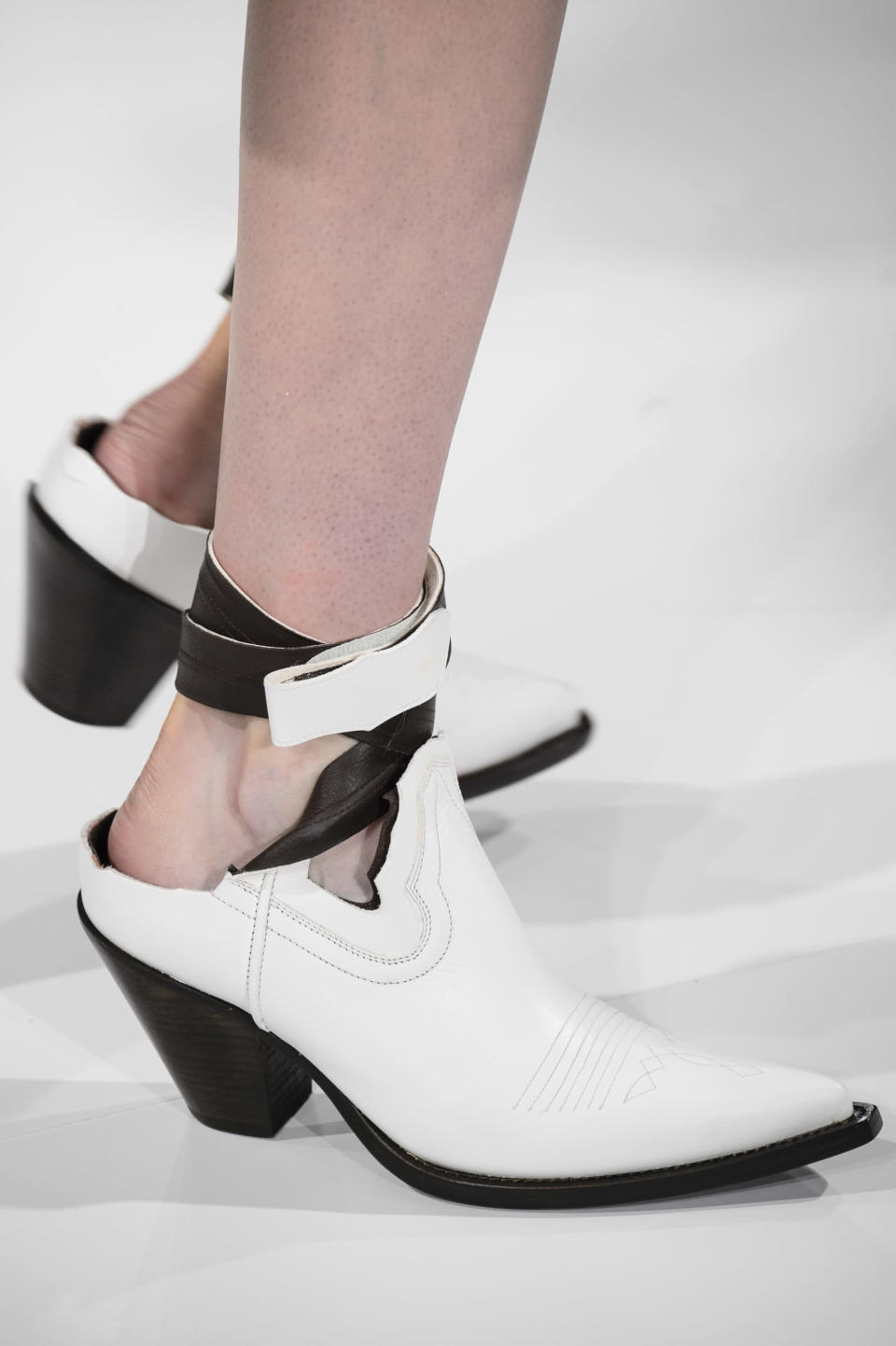<p><i>White western style boots from the SS18 Maison Margiela collection. (Photo: ImaxTree) </i></p>
