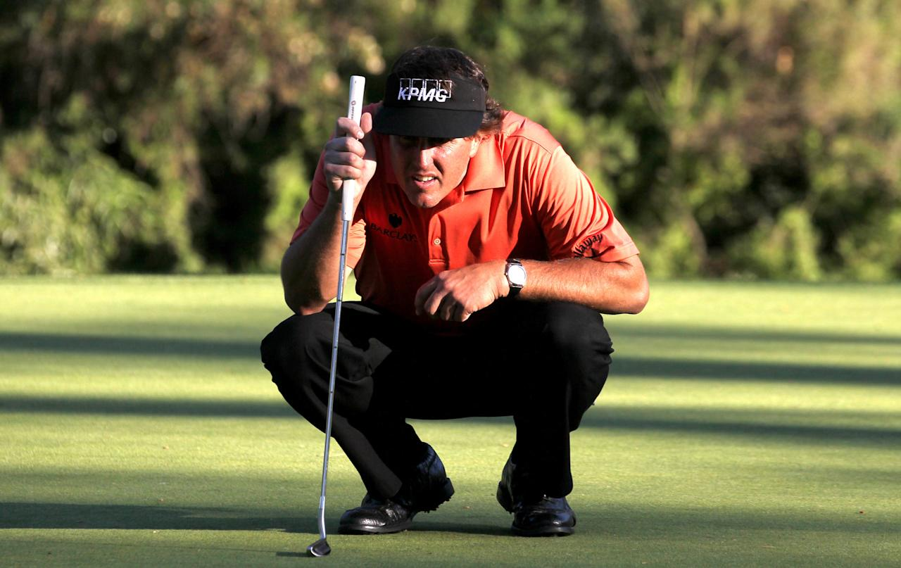 PACIFIC PALISADES, CA - FEBRUARY 16:  Phil Mickelson lines up his putt on the 13th hole during the first round of the Northern Trust Open at Riviera Country Club on February 16, 2012 in Pacific Palisades, California.  (Photo by Stephen Dunn/Getty Images)